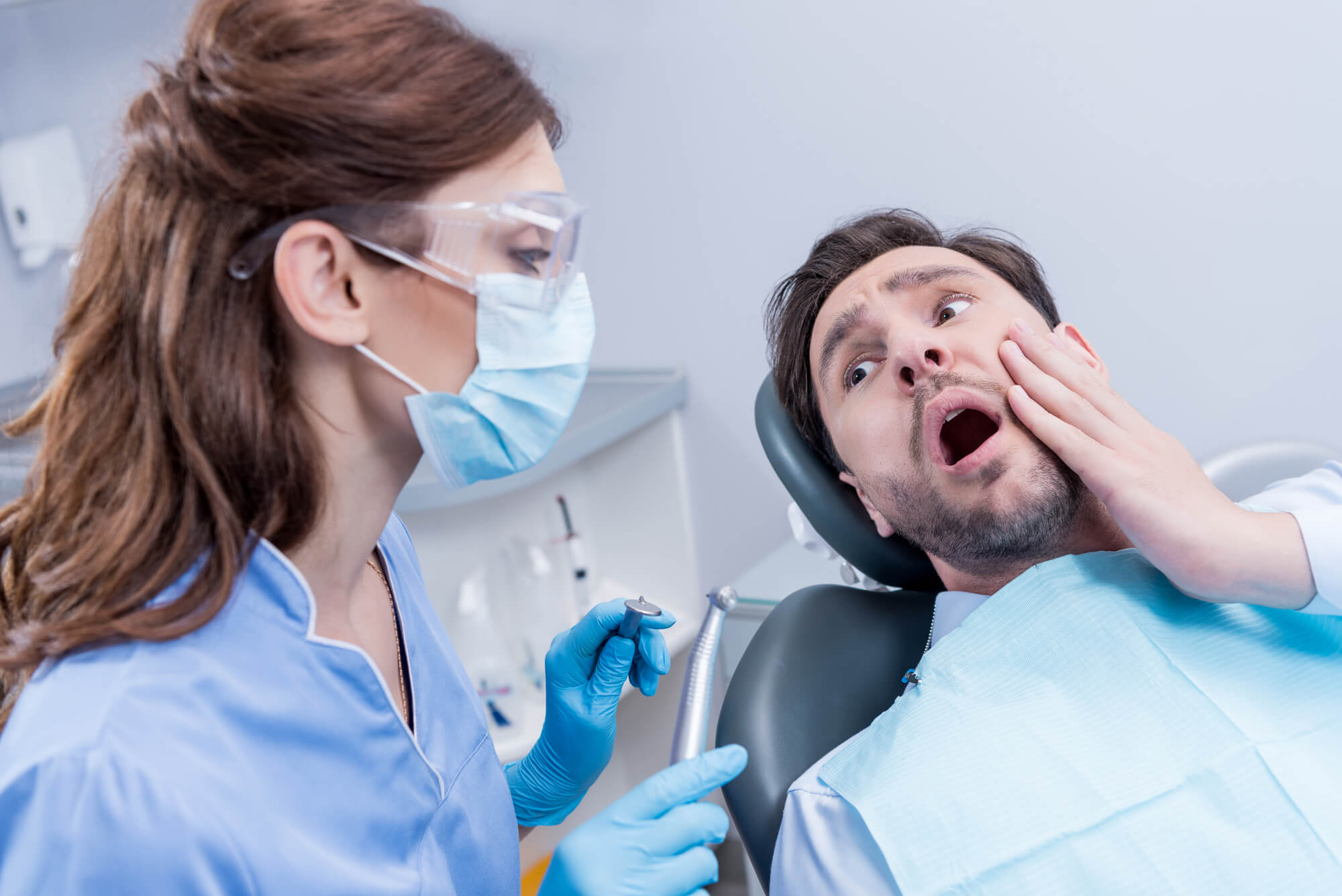 Scared patient at the dentist who needs Sedation Dentistry in Houston